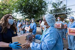 Bass Pro Shops workers hauled 6,000 face masks in a motorcade escorted by the Alachua County Sheriff's Office to support health care workers at UF Health.