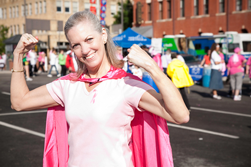 Woman in pink superhero cape