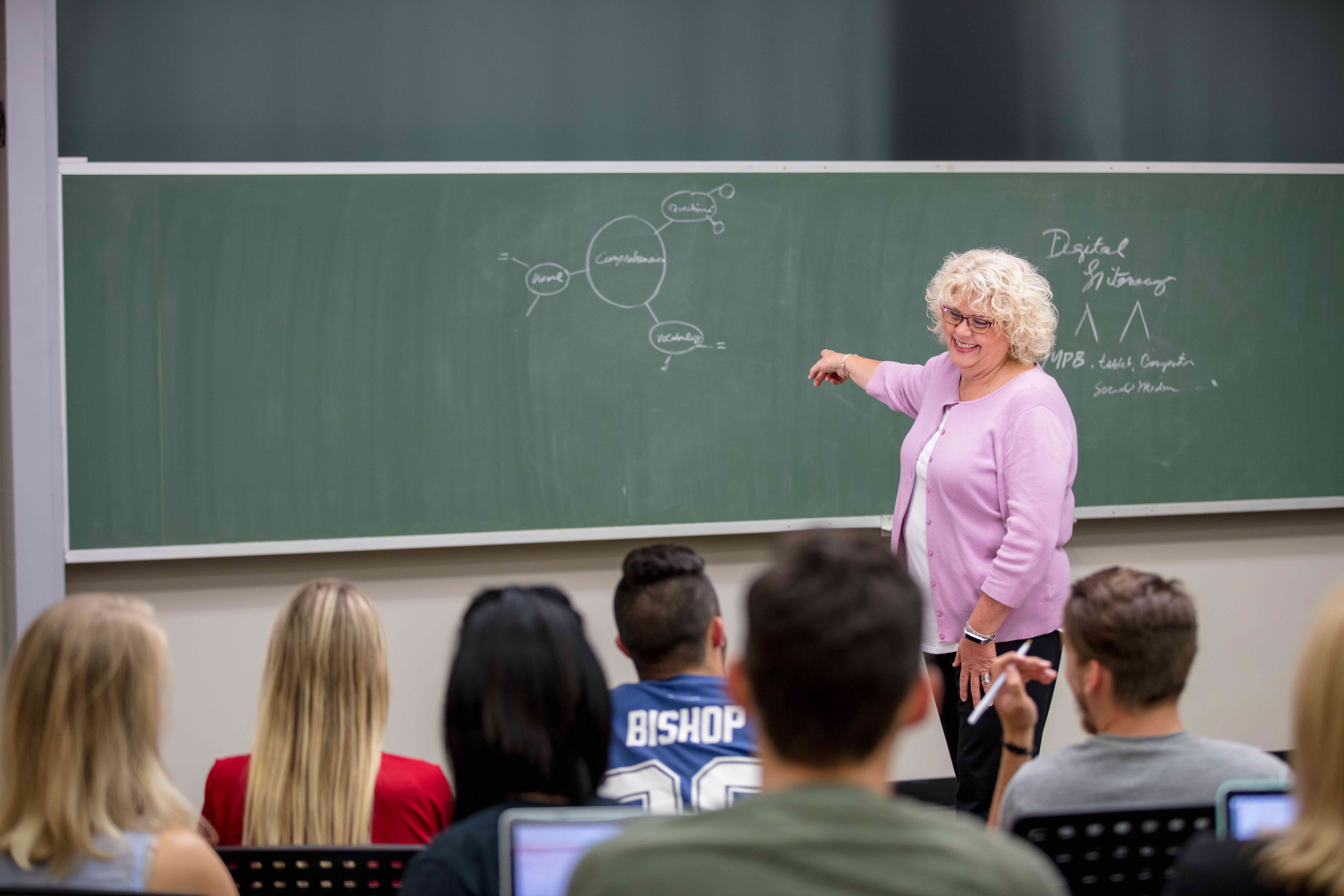 Debbie Paine teaching students in her classroom.
