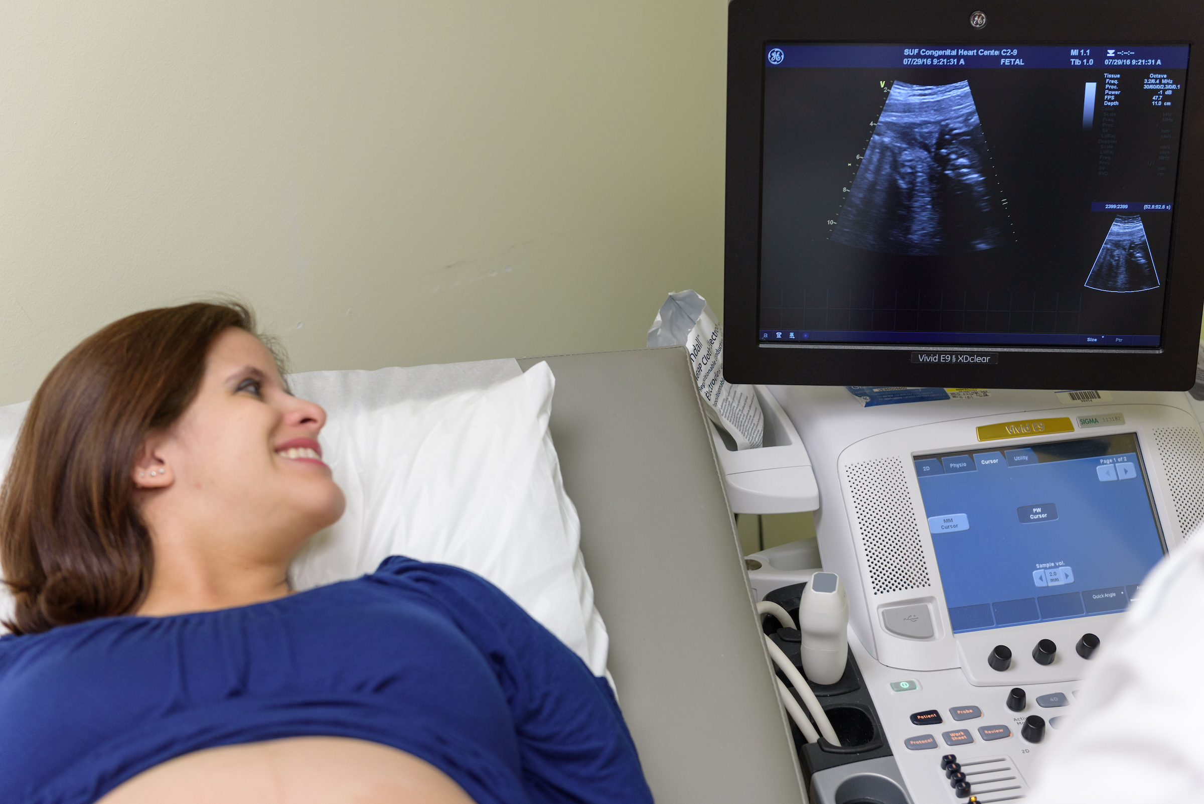 Pregnant woman receiving an ultrasound.