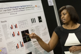 A UF researcher explains her work during the 2014 College of Medicine Celebration of Research.