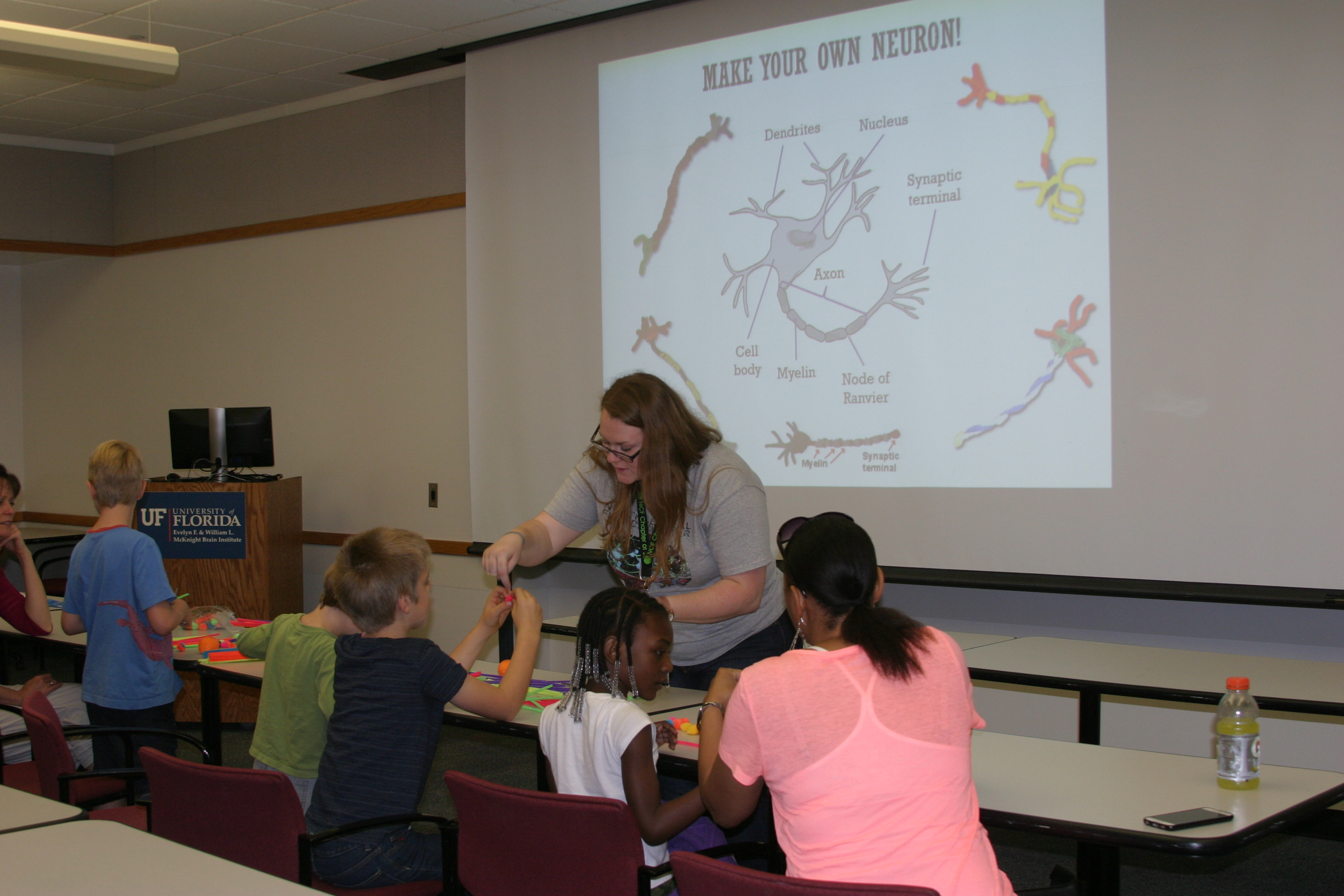 UF doctoral student Nicola Rutherford helps area homeschooled children make models of neurons.