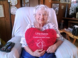 Rosalie Youngerman, 89, relaxes in the comfort of her home with a pillow she received signed by the cardiovascular team at UF Health. Photo by Rossana Passaniti