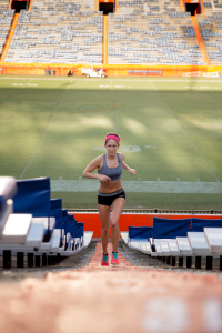 A student runs up the stairs of Ben Hill Griffin Stadium in this 2015 photo. Physical activity has many health benefits. But what changes does it cause on a molecular level? (Photo by Hannah Pietrick.)