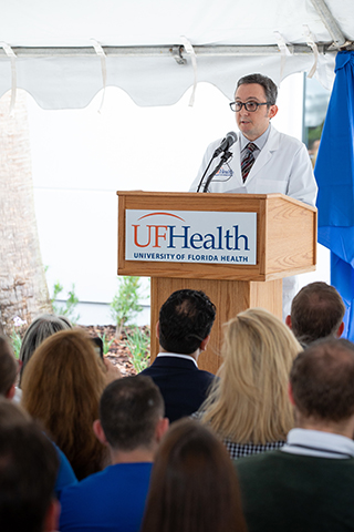 Michael S. Okun, M.D., Executive Director, Norman Fixel Institute for Neurological Diseases addresses attendees during the ribbon-cutting for the Norman Fixel Institute for Neurological Diseases at UF Health on Wednesday, June 19.
