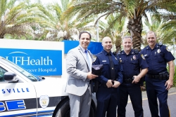 Ed Jimenez, chief operating officer and senior vice president of UF Health and trauma kit, is joined by John Slish, M.D., a University of Florida assistant professor of emergency medicine and a Tactical Casualty Combat Care instructor, Gainesville Police Department Lt. Dan Stout and Gainesville Police Department Capt. Ed Posey.