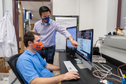 Dr. Liang Zhou and his graduate student, Joseph Dean, review recent findings published by their lab relating to the protein Ahr. (Photo by Jesse Jones)