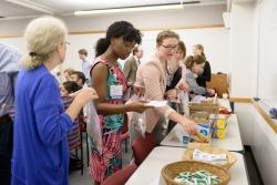 """Colleagues and students of Dr. Richard Christensen fill """"manna bags"""" for the homeless in his memory."""