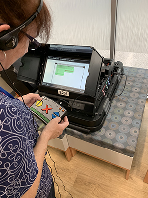 A special voting machine allows people with low vision to make adjustments to the display screen while casting a ballot in Alachua County.