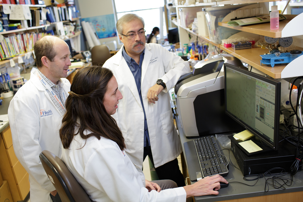 New findings by UF neuroscientists (from left) Todd Golde, M.D., Ph.D., Brenda D. Moore, Ph.D., and Diego Rincon-Limas, Ph.D., at the McKnight Brain Institute may open a new avenue for treatment of Alzheimer's disease.