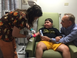 Will Barkoski, 9, receives the first commercially available dose of a new therapy for Duchenne muscular dystrophy at UF Health Shands Children's Hospital.