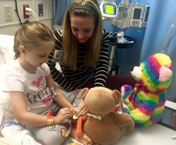 "Hadley ""Powie"" Patterson learns about her treatment thanks to the teddy bear clinic, a service of Child Life. One of the programs funded by Children's Miracle Network Hospitals, Child Life helps to ease the anxiety of hospitalization for patients and their families."