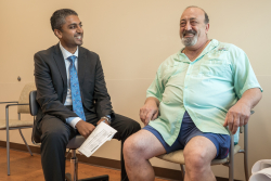 UF Health anesthesiologist Ajay B. Antony, M.D., meets with his patient Felix Favicchio, the first person in Florida to receive a new generation neurostimulation implant device for people living with chronic back pain.