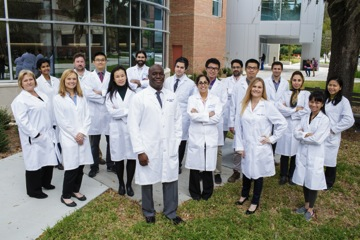 Members of the Preston A. Wells, Jr. Center for Brain Tumor Therapy at the University of Florida gather outside the McKnight Brain Institute at UF. (Copyright: University of Florida)