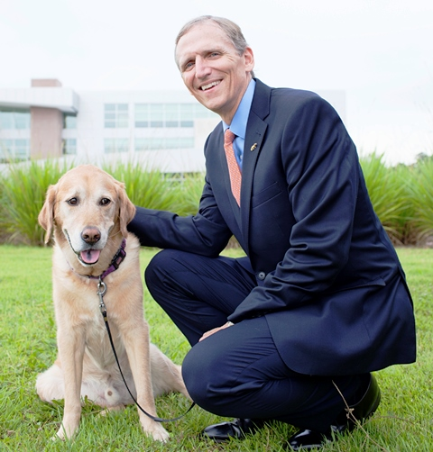 Dean James W. Lloyd in front of the UF Small Animal Hospital.