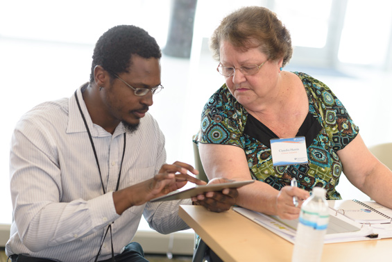 Research coordinator Damian Alderman works with Claudia Harris, a participant in the CTSI Citizen Scientist Program.