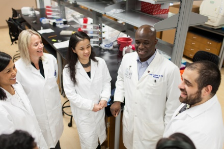 Dr. Duane Mitchell (second from the right) with his new faculty and staff in the Brain Tumor Research Program.