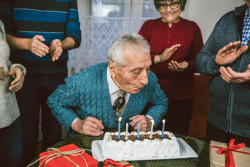 An ongoing UF Health study seeks to understand how 45,000 of the healthiest Floridians age 90 and older aged successfully. Here, a grandfather celebrates his birthday with family. (Getty Images|Urbazon)