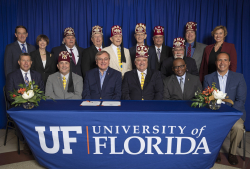 The new relationship between Shriners Hospitals for Children and UF Health was recognized Oct. 4 with a signing ceremony that included UF President Kent Fuchs, members of the SHC-Florida Board of Governors, and the members of UF Foundation Board of Directors.  Photo by Aaron Daye