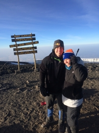 Amy Bucciarelli, an art therapist for UF Health Shands Arts in Medicine, and Dr. Chris Bucciarelli, chief resident in the department of emergency medicine in the UF College of Medicine, recently climbed Mount Kilimanjaro as part of a Climb for Cancer Foundation trip. They took part to raise money for the foundation's efforts to help cancer patients, and to honor their father, UF's Dr. Richard Bucciarelli, who has an aggressive form of melanoma.