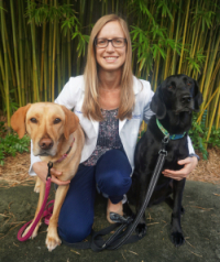 Allison O'Kell, D.V.M., with her two dogs.