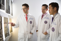 (From left) UF Health neurosurgeons William Fox,  M.D., Adam Polifka, M.D. and Daniel Hoh, M.D., are part of a multidisciplinary  team improving care for patients with back and neck pain at the UF Health  Comprehensive Spine Center.