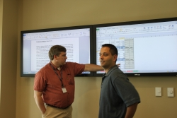 Jeff Sanford and UF veterinary student Jonathan Williams discuss a practitioner's financial report back in the classroom after an initial meeting. (Photo by Sarah Carey)