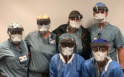 A group of anesthetists wear the completed shields.