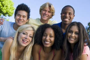 Teens smiling as they fight against bullying.