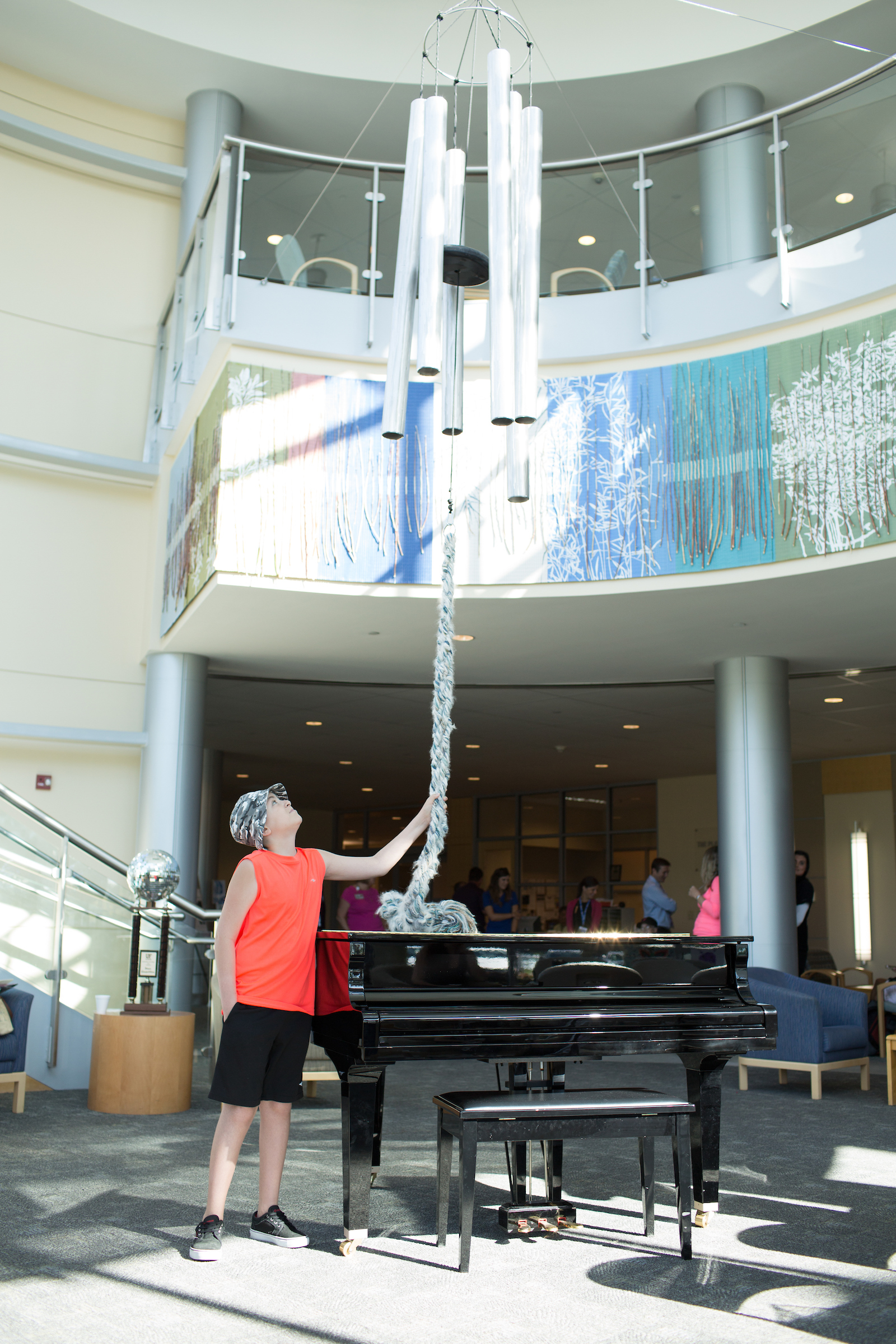 patient ringing chimes after completing proton therapy treatment