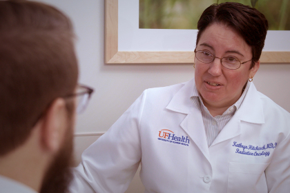 doctor Kathryn Hitchcock of Radiation Oncology talking with a patient