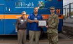 Left to right: Tim Lambert, ESGR Florida vice chair, Mark Thomas, ShandsCair operations manager, and Michael Johnson, ShandsCair ground medic.