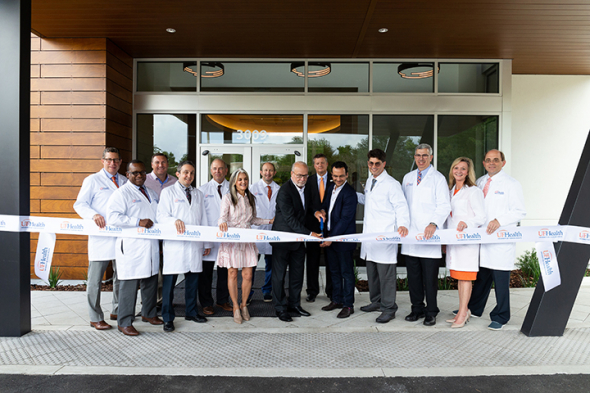 UF Health leadership and the Fixel family cut the ribbon on the new Norman Fixel Institute for Neurological Diseases at UF Health on June 19, 2019.