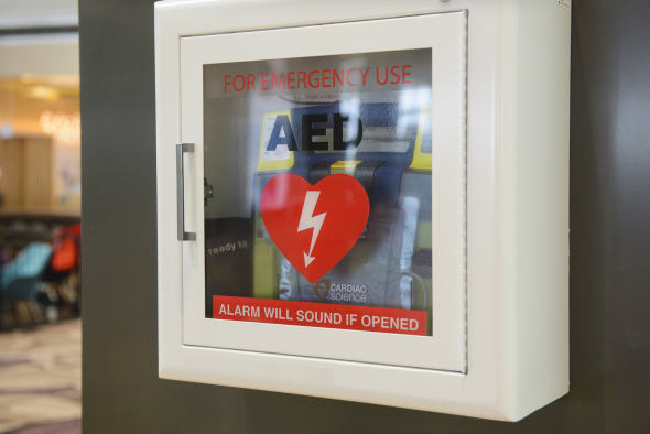 an AED box mounted to the wall