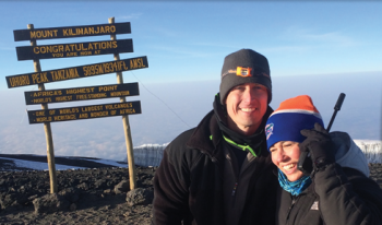Two of UF Health's own climbed Africa's highest peak to raise money to honor their father and raise money to fight cancer
