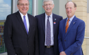 UF President Kent Fuchs, NIH Director Dr. Francis Collins, and senior vice president for health affairs at the University of Florida and president of UF Health David Guzick