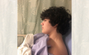 profile view of a teen boy in a hospital gown in a hospital bed