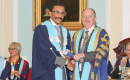 Rui Fernandes, M.D., D.M.D., receives and award and looks super happy