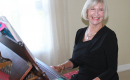 Jane playing piano and smiling